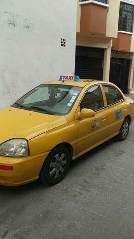 Por motivo de viaje, vendo taxi amarillo papeles en regla, con placas y cooperado. Año 2013, sin multas y matriculado.