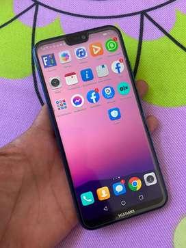 Vendo cambio Huawei p20 Lite bonito huella 32gb