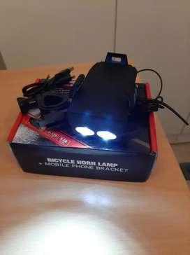 Luces LED, bocina y porta celular