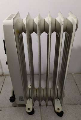 Radiador eléctrico - Estufa electrica aceite Dhinco 1000 W
