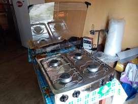 Cocineta a Gas 4 Quemadores total acero poco uso