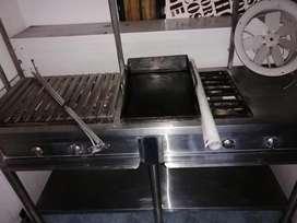 Vendo estufa en acero inoxidable con campana extractora