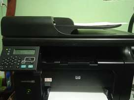 Impresora láser multifuncional HP m1212fn