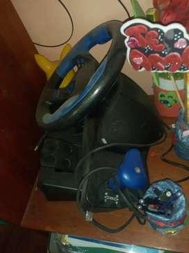 Play 2 en buen estado con sus dos palancas y sus dos memorias 8GB y juegos adicionales +volante con pedal para PC y play