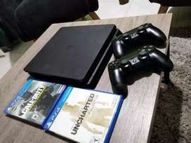 Playstation 4 slim 1 tera, 2 controles, 2 juegos
