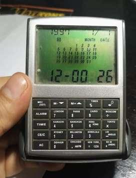 Vendo calculadora portatil con reloj y calendario vintage