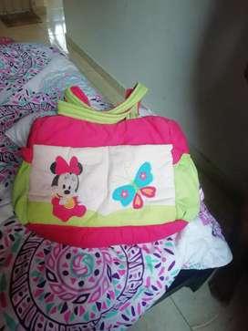 Vendo bolso para bebé y un protector de cuna