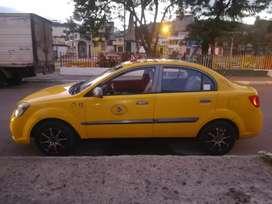 Vendo taxi con puesto y acciones en la cooperativa