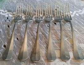 Antiguos tenedores de alpaca