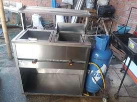 Se vende estufa industrial para comidas rapidas y se vendidase vitrina para venta de comida en muy buen estado