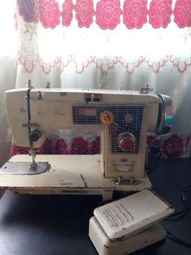 Máquina de coser para reparar