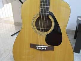 vendo hermosa guitarra acustica yamaha F 310 con estuche duro