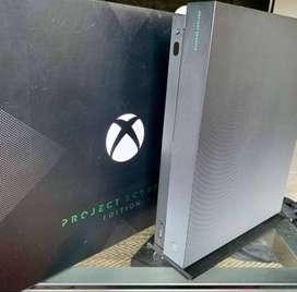 Consola Xbox One X Project Scorpio De 1tb + 1 Estaciones de Carga + 1 Juego