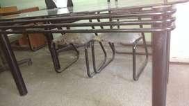 Juego de Comedor de caño y vidrio con 1 mesa + 6 sillas con apoyabrazo