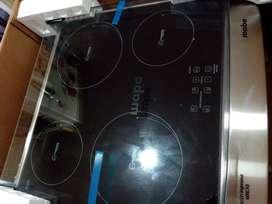 Flamante cocina de inducción Mabe con horno