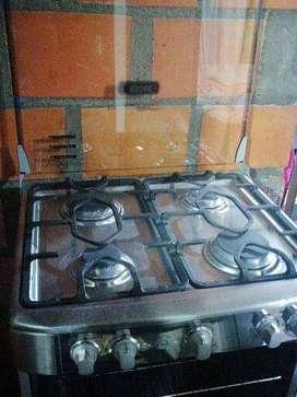Estufa mabe cuatro quemadores con horno