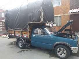Hermosa camioneta de carga 4X2 estacas con cilindraje 1600 cc.