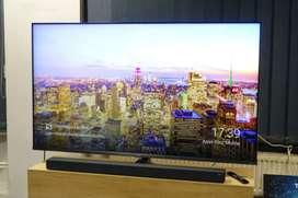 Tv lg de 65 pulgadas nuevo mas barra de sonido