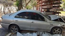 VENDO NISSAN ALMERA CHOCADO