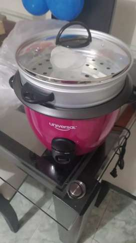 Se vende olla arrocera color fucsia