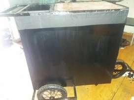 Vendo mi carrito d salchipapa o papi pollo con vitrina d vidrio recién pintado y decorado