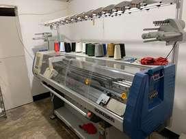 Operario de maquina tejedora.