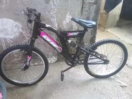 Bicicleta todo terreno doble suspensión color negro con fucsia.  Precio negociable todo nuevo