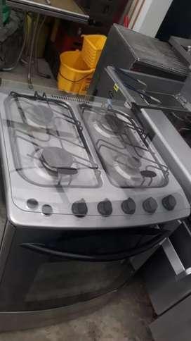 Estufa con horno a gas Haceb