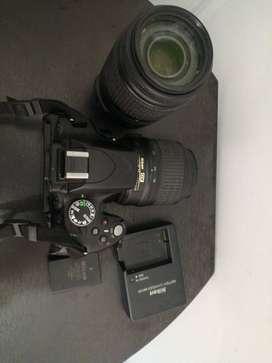 cámara Nikon D5100 con lente 55mm -300mm