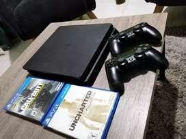 Playstation 4 slim 1 tera, 2 controles, 2 juegos.