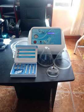 Equipos de vacumterapia estética con sus copas y manguera