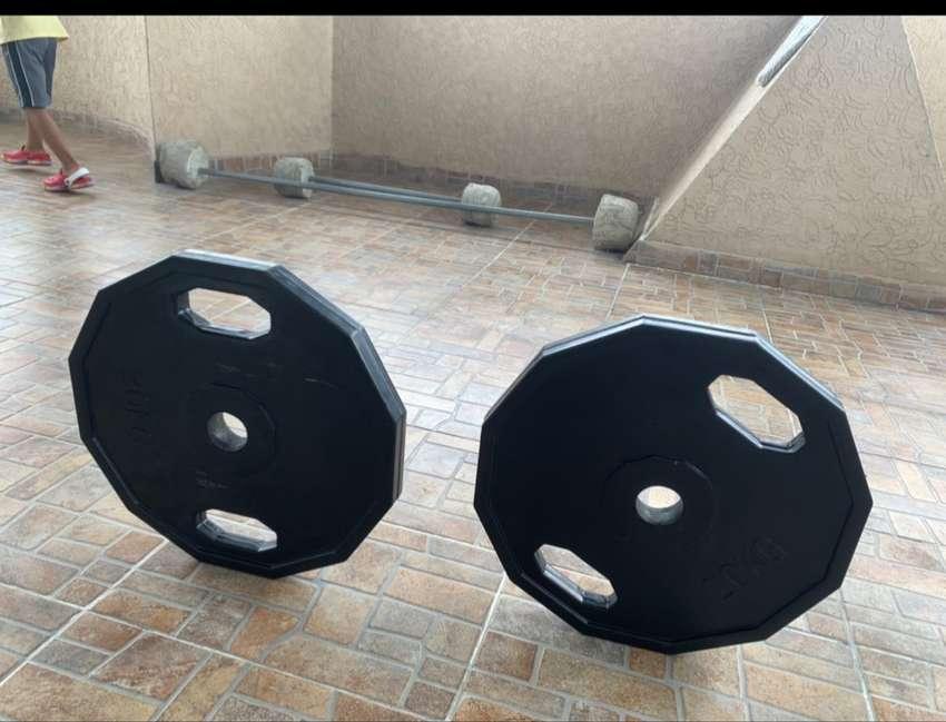 Par de discos encorchetados de 20kg