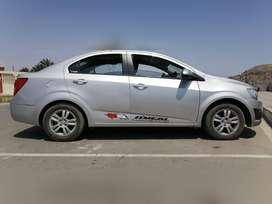 Chevrolet sonic sedan 2014 solo gasolina año 2014 uso particular. Color plateado en buen condición luna y pestillo elect