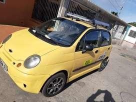 Taxi spark  recién  reparado y se permuta