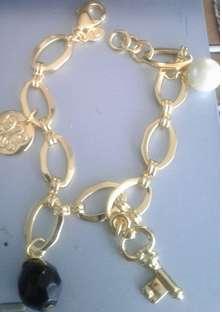coleccion collar aretes y pulsera perli black yanbal