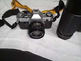 Camara canon   más  lente profesional canon y camara yashica