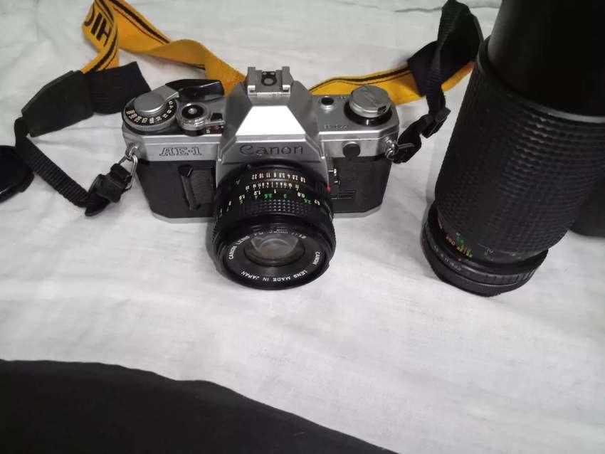 Camara canon   más  lente profesional canon y camara yashica 0