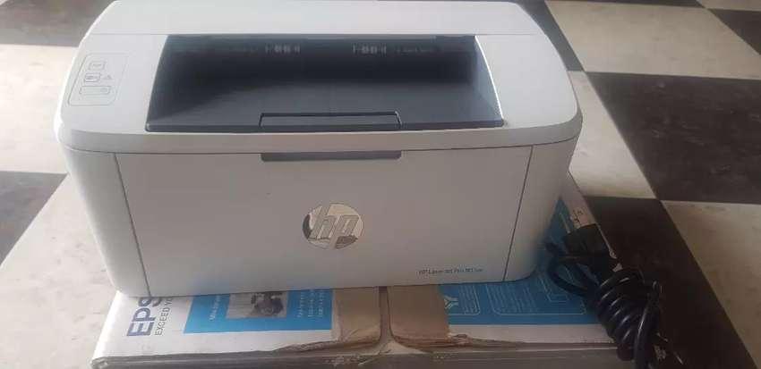 Impresora  HP LASER 15W monocromatica 0