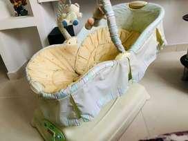 Vendo silla mecedora musical Fisher prin para bebe