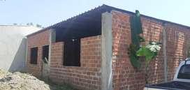 Venta de terreno con casa en construcción en pasaje .. el gran deportista