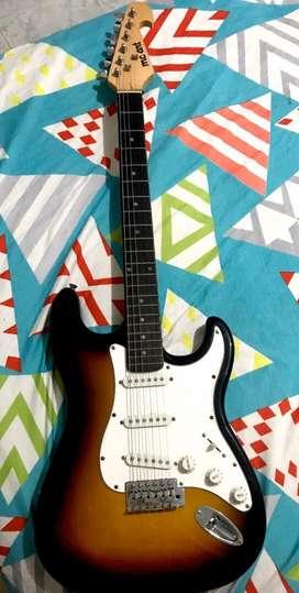 Guitarra electrica y amplificador de sonido
