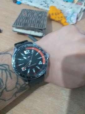 Reloj Tommy malla de goma.