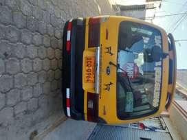 Vendo furgoneta escolar amarillo con negro con  acciones en compañía Peregrinos