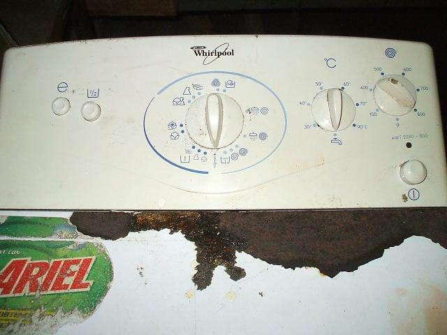 lavarropas de 4 kg.de ropa marca whirpool carga superior.info adentro 0