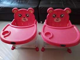 Vendo silla comedor para bebe, color fucsia, marca Mobilu