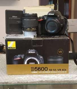 16mil disparos casi nueva Nikon D5600 + lente 18-55mm + cargador bateria manual y correa