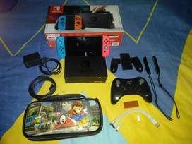 Nintendo Swicht con todos sus accesorios , memoria de 128 GB , control Wii u pro + 8 bitdo
