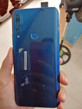 Vendo y9prime color azul  128 gigas con caja y cargador $550000