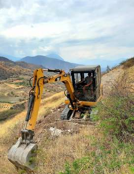 mini excabadora Caterpillar 100% operativo