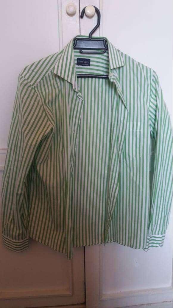 blusa blanca con rayas verdes talla L marca linea sports